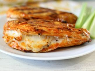 Grilled buffalo chicken stuffed with mozzarella